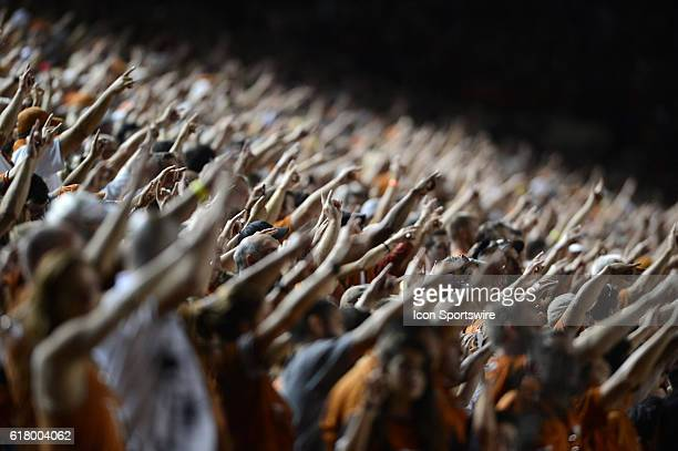 Longhorn fans salute with the Hook 'em sign during 27 6 win over Iowa State at Darrell K Royal Texas Memorial Stadium in Austin TX