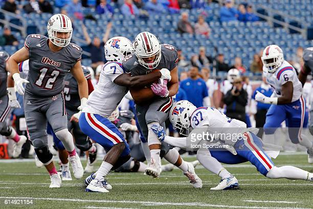 Louisiana Tech Bulldogs safety Xavier Woods and Louisiana Tech Bulldogs cornerback Ephraim Kitchen combine to stop UMass fullback John...