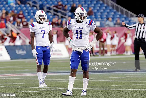 Louisiana Tech Bulldogs safety Xavier Woods and Louisiana Tech Bulldogs safety Lloyd Grogan check the defensive signals from the sideline. The...