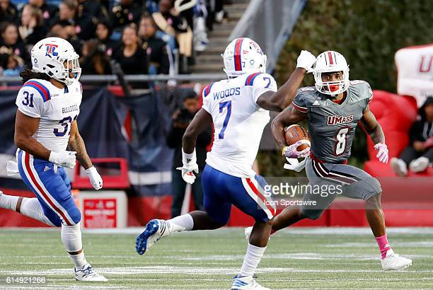 Louisiana Tech Bulldogs safety Xavier Woods closes down UMass running back Marquis Young . The Louisiana Tech Bulldogs defeated the UMass Minutemen...