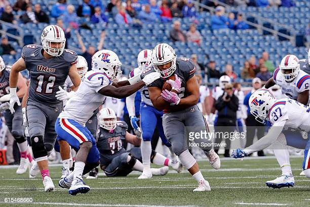 Louisiana Tech Bulldogs safety Xavier Woods tries to stop \UMass fullback John Robinson-Woodgett . The Louisiana Tech Bulldogs defeated the UMass...