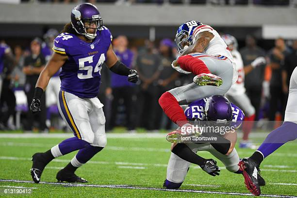 Minnesota Vikings Safety Harrison Smith tackles New York Giants Wide Receiver Odell Beckham Jr in action during a Monday Night Football game between...