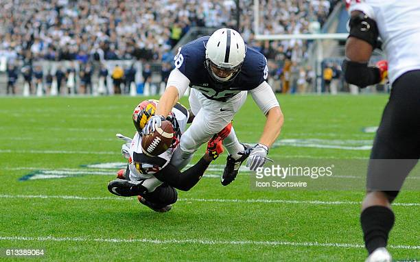 Penn State TE Mike Gesicki reaches the ball across the goal line for a first quarter touchdown as Maryland S Darnell Savage Jr holds onto his legs...