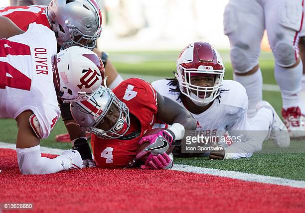 Running back Curtis Samuel of the Ohio State Buckeyes looks for the touchdown call from the official after diving across the goal line during the...