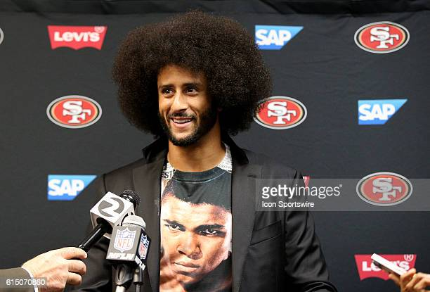 San Francisco 49ers quarterback Colin Kaepernick talks to reporters during a press conference after an NFL game between the San Francisco 49ers and...