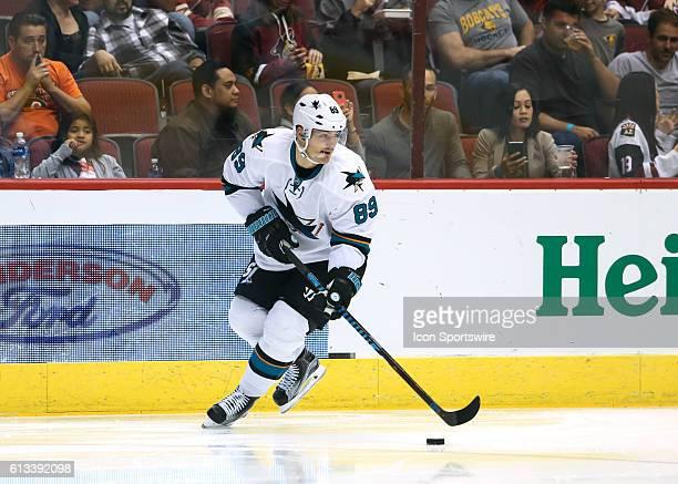 San Jose Sharks forward Mikkel Boedker moves the puck during the preseason NHL hockey game between the San Jose Sharks and the Arizona Coyotes at...