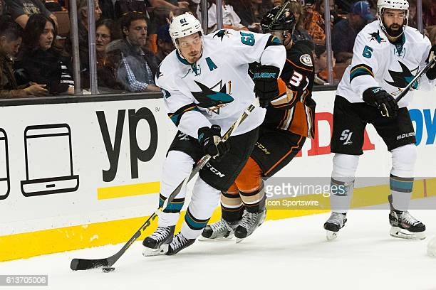 San Jose Sharks Justin Braun tries to clear the zone during the 3rd period of a preseason NHL game between the San Jose Sharks and the Anaheim Ducks...