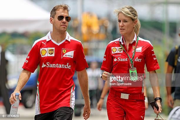 Sebastian Vettel of Scuderia Ferrari with Britta Roeske Ferrari Press Officer at the paddock of the Formula 1 Petronas Malaysia Grand Prix held at...