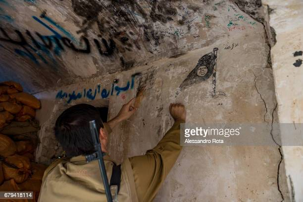 26 October 2016 Sinjar Iraq Signs left behind by ISIS in the city are shown by a a PDK spokeperson Sinjar city had a mixed population of yazidi...