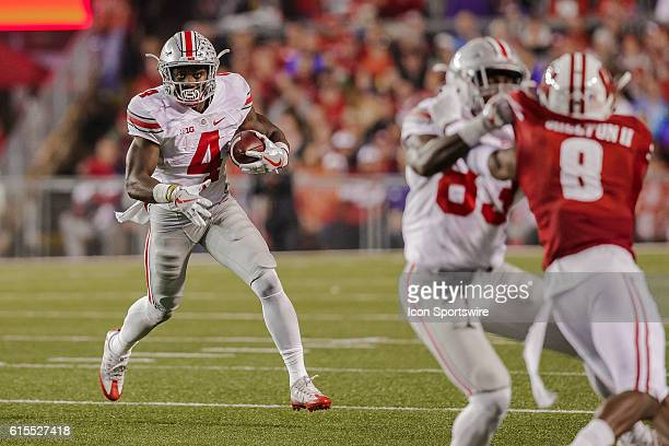 The Ohio State Buckeyes hback Curtis Samuel looks for running room as the 2nd ranked Ohio State Buckeyes defeat the 8th ranked Wisconsin Badgers in...