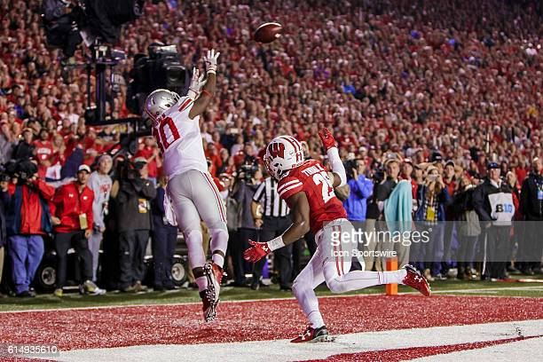 The Ohio State Buckeyes wide receiver Noah Brown catches the game winning touchdown over Wisconsin Badgers corner back Derrick Tindal as the 2nd...