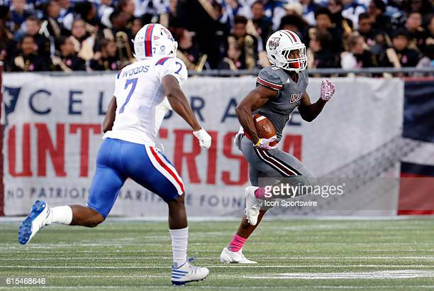UMass running back Marquis Young tries to get past Louisiana Tech Bulldogs safety Xavier Woods . The Louisiana Tech Bulldogs defeated the UMass...