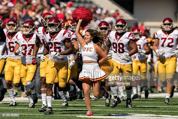 USC Trojan players run onto the field with cheerleaders before the NCAA football game between the Arizona Wildcats and the USC Trojans at Arizona...