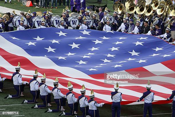 Washington band members held the American flag during the singing of the Star Spangle Banner Washington defeated Oregon State 4117 at the University...