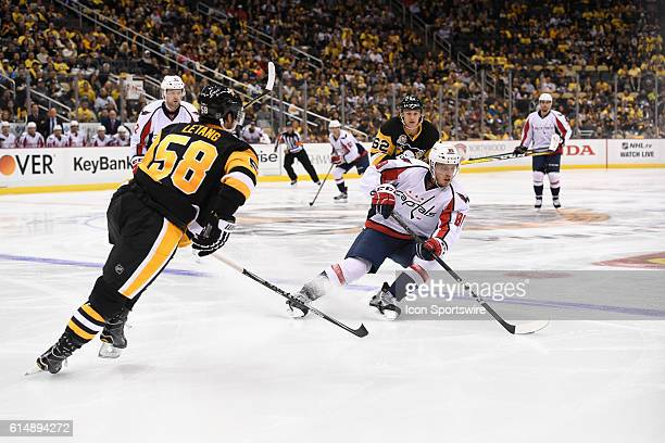 Washington Capitals Defenceman Nate Schmidt skates the puck into the zone in front of Pittsburgh Penguins Defenceman Kris Letang during the third...