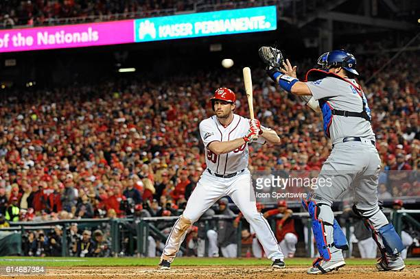 Washington Nationals second baseman Daniel Murphy is intentionally walked as Los Angeles Dodgers catcher Yasmani Grandal takes the throw at Nationals...