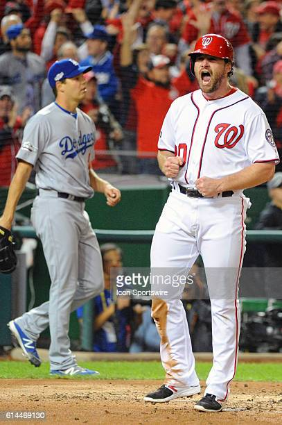 Washington Nationals second baseman Daniel Murphy reacts after scoring as Los Angeles Dodgers starting pitcher Rich Hill backs up the play in the...