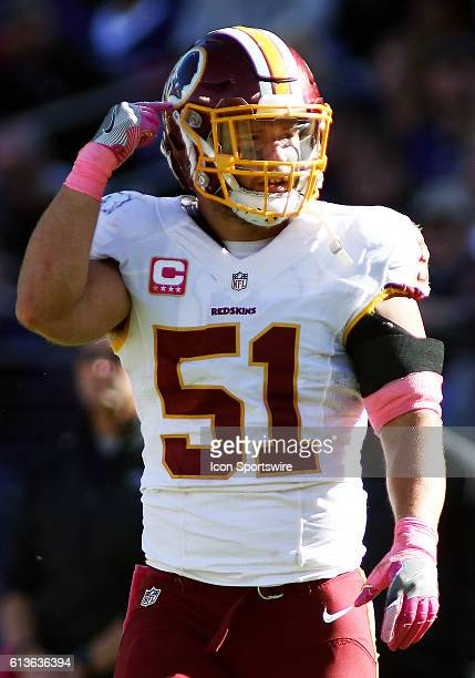 Washington Redskins inside linebacker Will Compton taunts the crowd as he points to his helmet during a match between the Baltimore Ravens and the...