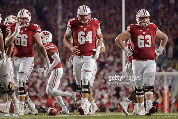 Wisconsin Badgers offensive lineman Brett Connors and Wisconsin Badgers offensive lineman Michael Deiter get ready to line up for a play as the 2nd...