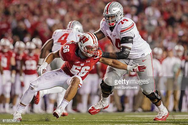 Wisconsin Badgers outside linebacker Zack Baun tries to rush past The Ohio State Buckeyes offensive lineman Jamarco Jones as the 2nd ranked Ohio...