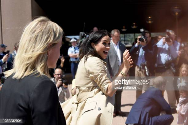 Duchess Meghan welcomes fans in front of the opera house Prince Harry and his wife Meghan are on their first official joint trip abroad since the...
