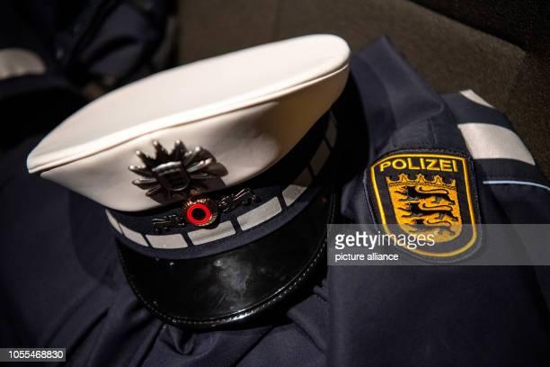 October 2018, Baden-Wuerttemberg, Stuttgart: A uniform of the Baden-Württemberg police lies on an armchair. Photo: Sebastian Gollnow/dpa
