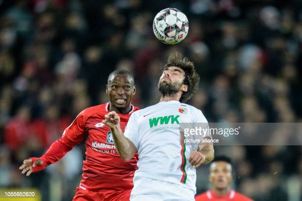 Soccer DFB Cup FC Augsburg FSV Mainz 05 2nd round in the WWK Arena Anthony Ujah from Mainz and Jan Moravek from FC Augsburg in a header duel for the...