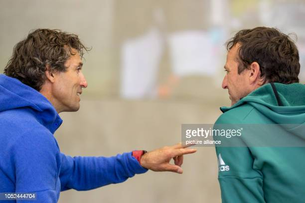 Peter Schlickenrieder national trainer in crosscountry skiing talks to Werner Schuster national trainer in ski jumping on the sidelines of the...