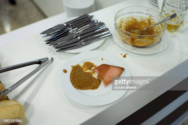 14 October 2018 Germany Munich A bitten slice of Leberkaese with mustard is lying on a counter in the federal office of the CDU during the election...