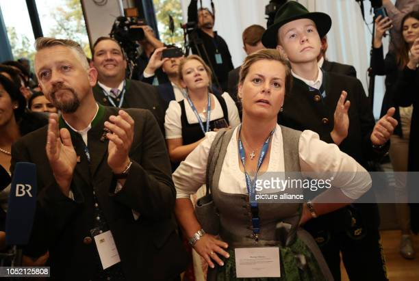 14 October 2018 Germany Munich CSU supporters react to the announcement of the forecasts at the CSU election party in the state parliament Voters in...
