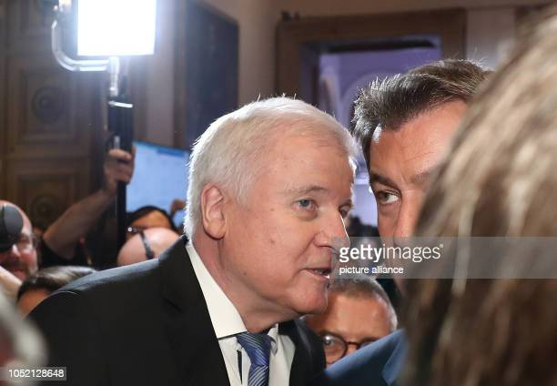 14 October 2018 Germany Munich Horst Seehofer and Markus Soeder talk to each other in the state parliament Voters in Bavaria have elected a new state...