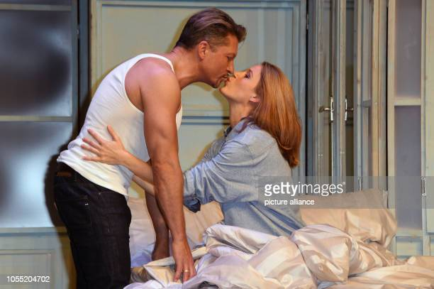 """October 2018, Bavaria, Munich: Actors Hardy Krueger jr. And Eva-Maria Grein von Friedl on stage during a photo rehearsal for the play """"Arthur und..."""