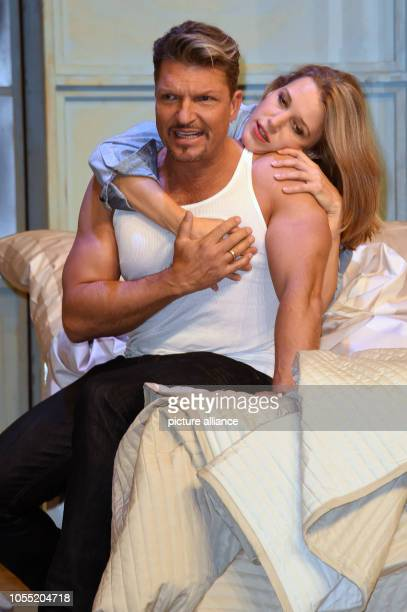 Actors Hardy Krueger jr and EvaMaria Grein von Friedl on stage during a photo rehearsal for the play Arthur und Claire in the Komoedie at the...