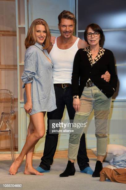 Actors Hardy Krueger jr EvaMaria Grein von Friedl and director and actress Ute Willing on stage during a photo rehearsal for the play Arthur und...