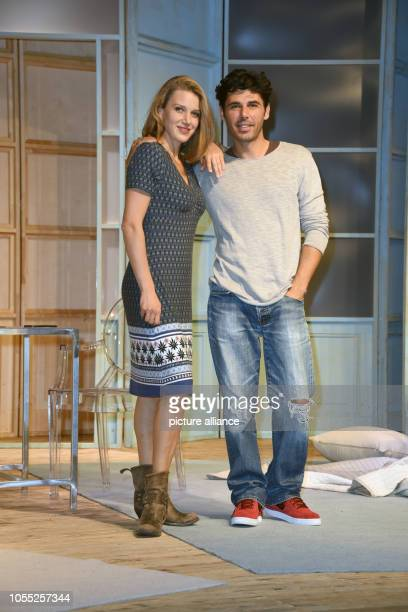 Actors Ricardo Angelini and EvaMaria Grein von Friedl on stage during a photo rehearsal for the play Arthur und Claire in the Komoedie at the...