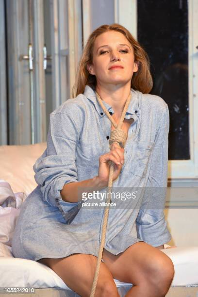 """October 2018, Bavaria, Munich: Actress Eva-Maria Grein von Friedl sitting on stage during a photo rehearsal for the play """"Arthur und Claire"""" in the..."""