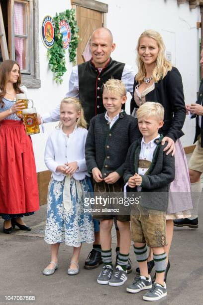 Arjen Robben from FC Bayern Munich comes with his wife Bernadien Eillert and their children Lynn Luka and Kai to the Käfer tent at the Oktoberfest on...