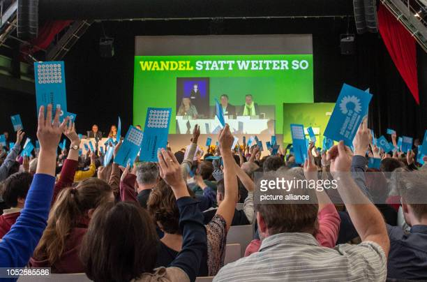 20 October 2018 Germany Regensburg Delegates hold up their voting cards at the extraordinary party conference of the Bavarian Greens in the...