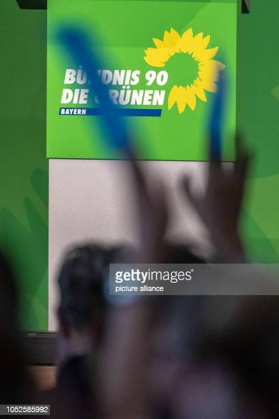 20 October 2018 Germany Regensburg Delegates hold up their voting cards at the extraordinary party conference of the Bavarian Greens Less than a week...