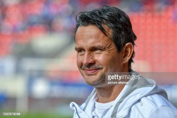 Soccer 2nd Bundesliga Jahn Regensburg Darmstadt 98 10th matchday in the Continental Arena Coach Dirk Schuster of Darmstadt stands before the match in...
