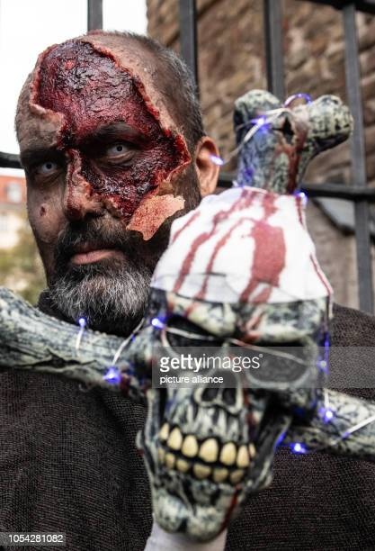 27 October 2018 Germany Berlin A participant of the ZombieWalk stands in the Klosterstrasse Photo Paul Zinken/dpa/ZB