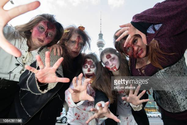 27 October 2018 Germany Berlin Participants of the ZombieWalk stand together for a photo in the background the television tower can be seen Photo...