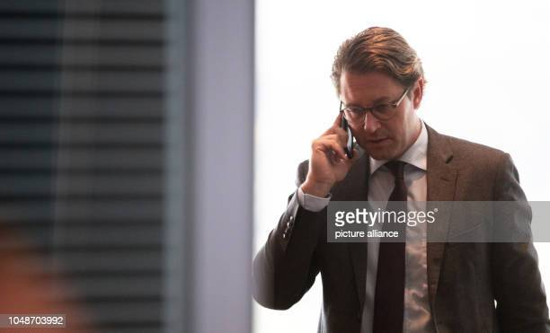 Andreas Scheuer Federal Minister of Transportation on the phone before a cabinet meeting in the Chancellor's Office Photo Ralf Hirschberger/dpa
