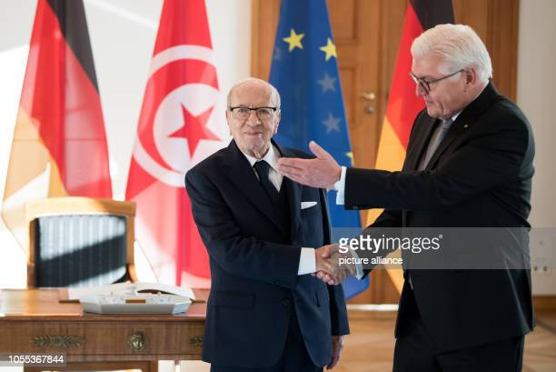 Beji Caid Essebsi President of Tunisia and Federal President FrankWalter Steinmeier shake hands in Bellevue Castle after the guest's entry in the...