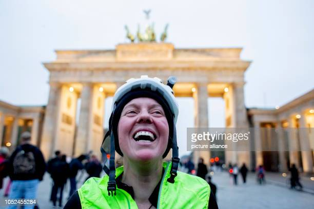 October 2018, Berlin: Jenny Graham laughs when she arrives at the Brandenburg Gate after having circumnavigated the world by bicycle. The British...