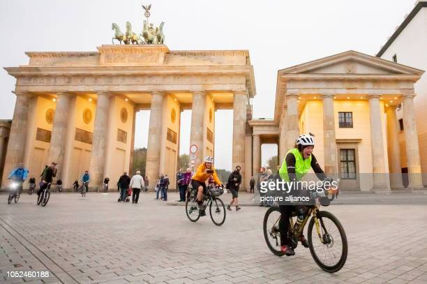 Jenny Graham laughs when she arrives at the Brandenburg Gate after having circumnavigated the world by bicycle The British woman was the first woman...