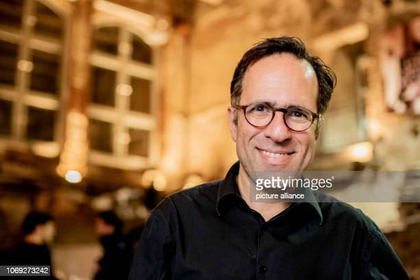 Mazda Adli cofounder and singer of the 'Singing Shrinks' is standing in the ruins of the Berlin Charité auditorium after the choir rehearsal The...