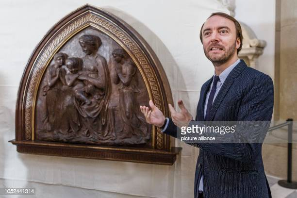 """October 2018, Berlin: Neville Rowley, curator for Italian art from 1500 at the Gemäldegalerie Staatliche Museen zu Berlin, stands next to the """"Mother..."""