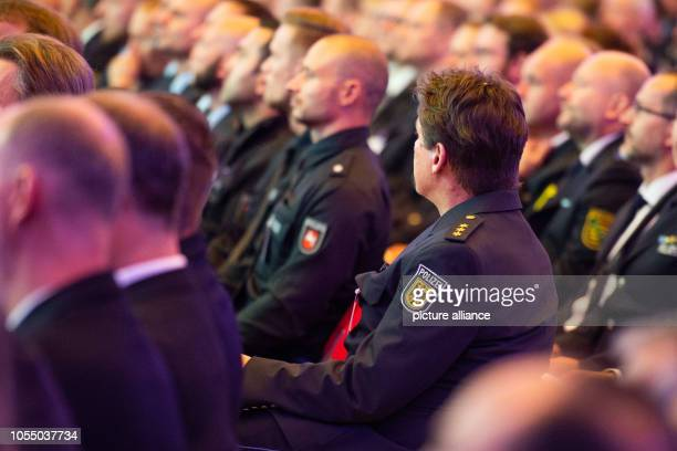 Police officers listening to a speech at a ceremony for police officers returning from foreign missions in the Berlin Congress Center For more than...