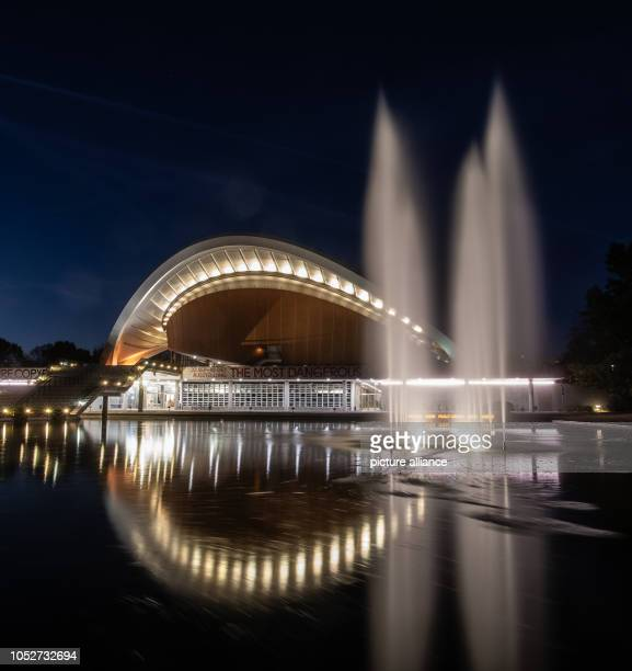 The House of World Cultured Art is brightly lit in the evening Photo Paul Zinken/dpa